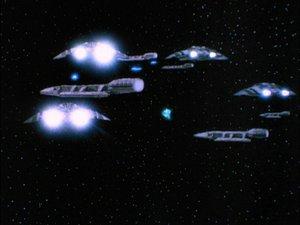 Cylon raiders begin the ambush on the battlestars