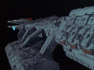 Galactica exchanges fire with the basestar.
