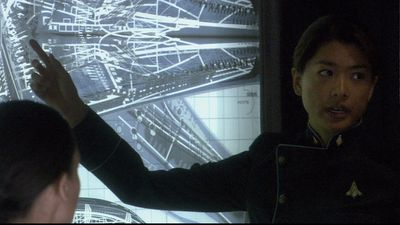 Sharon Agathon goes over interior plans of the Cylon basestar in a briefing.