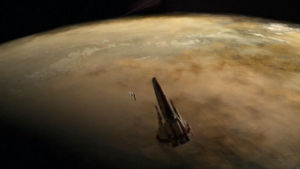 Starbuck's damaged Viper and the Cylon Raider are caught in the Red Moon's gravity field